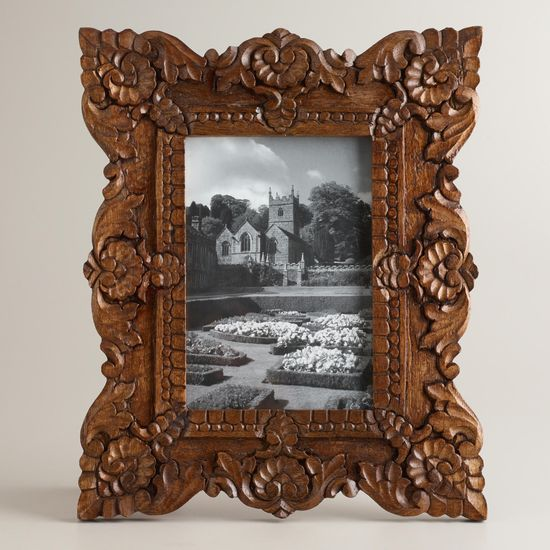 Tiny ornate frame with wedding photo for over the sink