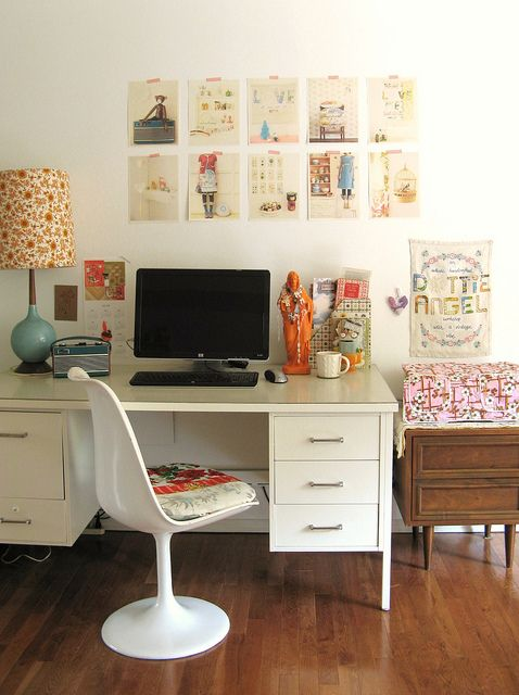 like the layout of desk and maybe several fashion prints above desk