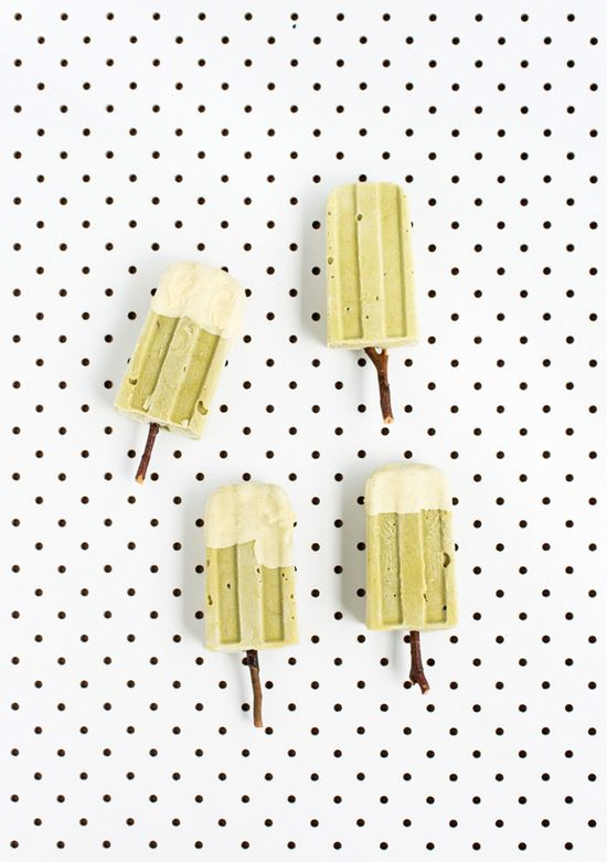 Matcha and avocado popsicles dipped in white chocolate