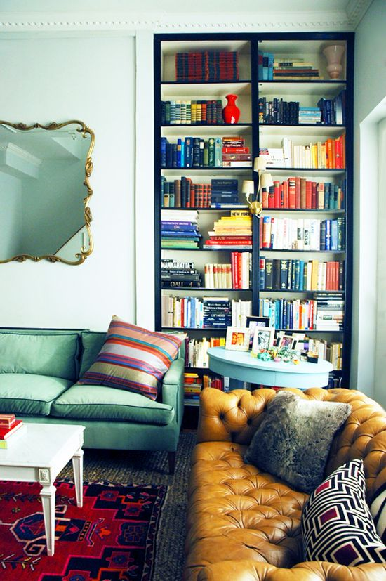 gold mirror over sea-foam couch (on Little Green Notebook)