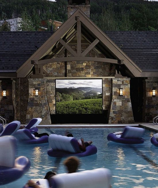 Floating in a swimming pool movie theater.