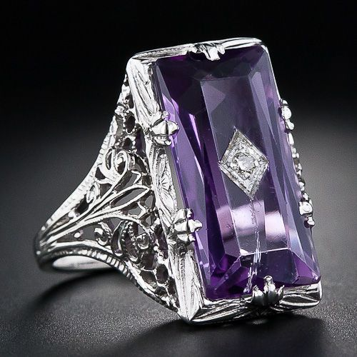 Art Deco amethyst and diamond filigree ring. Via Diamonds in the Library.