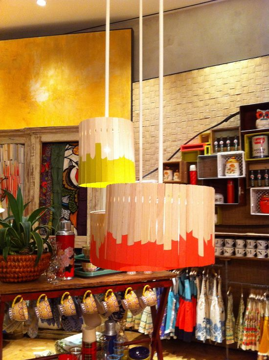 dipped paint stick pendant shades (anthropologie) - super easy to do with a handful of paint stirrers from your local paint store, an old lamp shade some paint to dip and a hit glue gun
