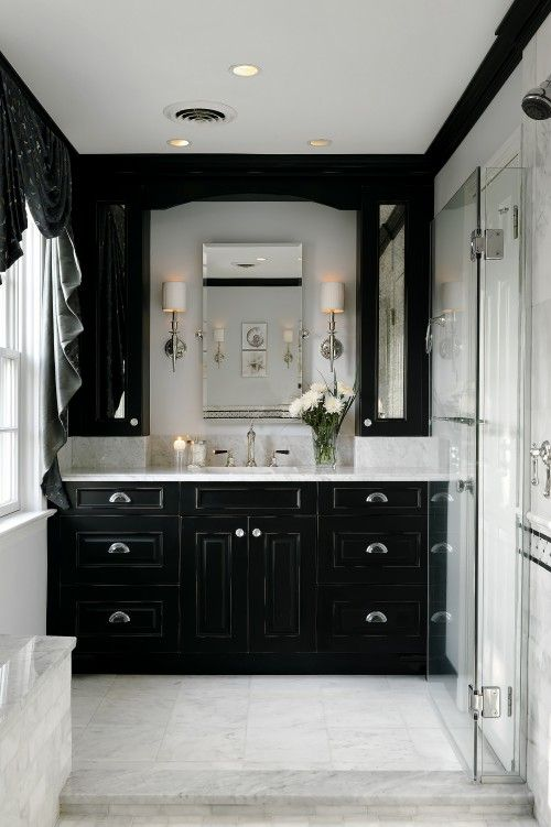 Idea to frame the mirror- build side cabinets with mirrored doors for all that extra stuff that end up on the counter by the kids....