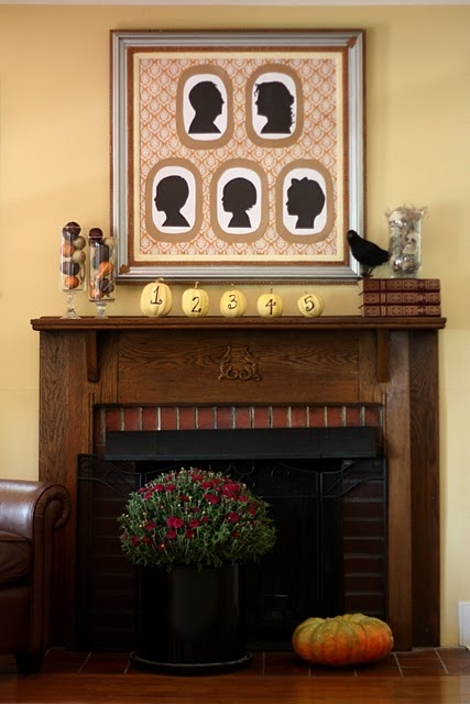 family silhouette mantel for a twist on Halloween decor