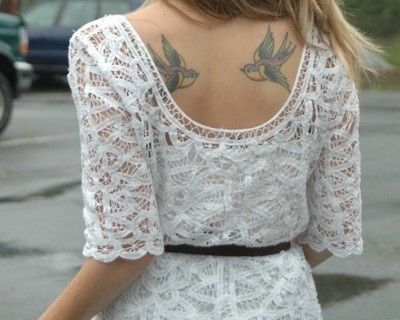 I like the dress, but the tatoo is pretty cool too