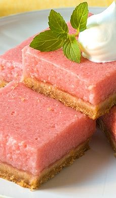 Mouth-Watering Watermelon Bars - made with watermelon, lemon juice and cream, they're served chilled and are perfectly complimented by a dollop of whipped cream or a dusting of confectioners' sugar.