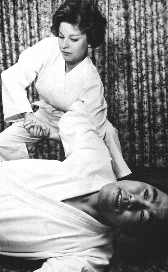 Lana Wood, best known for her role as Plenty O'Toole in the 1971 James Bond film Diamonds Are Forever, uses taekwondo against her Korean instructor, black belt Chan-Young Kim, in this photo from Fighting Stars magazine. #blackbeltmagazine #martialarts #taekwondo #tkd #actress #lanawood #koreanmartialarts #jamesbond #007 #fightingstars