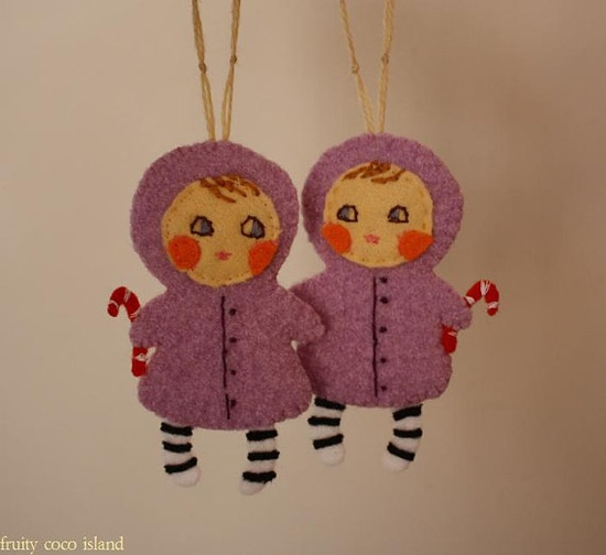 Twinsies! Felt Christmas ornaments.  Thinking about a series of felt children as ornaments. This idea would be a good start.