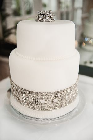 Ivory & Diamante Wedding Cake.  I love the way they have incorporated vintage jewelry on this beautiful cake.