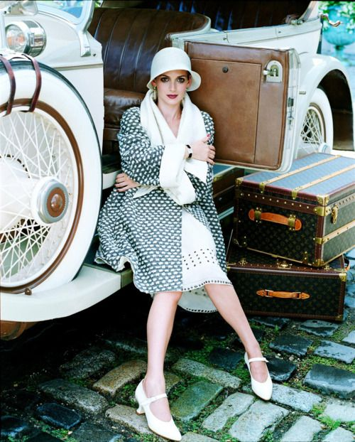 in her vintage car