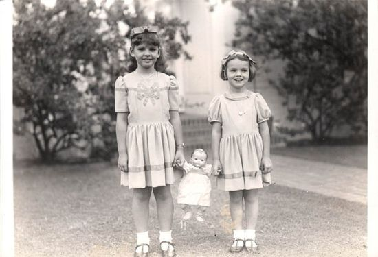 Vintage photo of two little girls with their doll (whose name is Mary May) circa 1940's - 1950's.