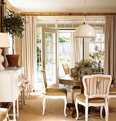 "Designer repainted an old pedestal table a glossy chocolate brown and painted a set of chairs white. The chairs gained new                                life with monogrammed fabric backs. Faux-ostrich vinyl, used on the seats, is both stylish and childproof. ""I just wipe them                                down with Windex after meals,"" Sandy says."