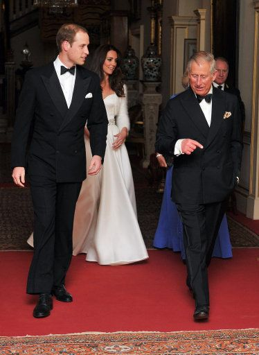 The Prince of Wales walks with The Duke of Cambridge followed by the Duchess of Cambridge and The Duchess of Cornwall, as they depart Clarence House to travel to Buckingham Palace for the evening wedding reception, 29 April 2011.