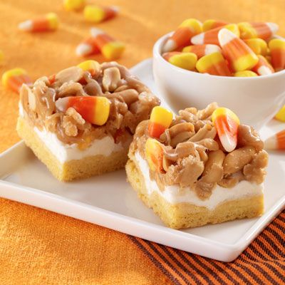 Scarecrow Treats--yellow cake crust, marshmallow middle, and a peanut butter, peanut, and candy corn topping.