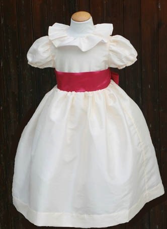 Lovely ivory flower girl dress with ruffled collar, fuchsia sash and puff sleeves. Design: littleeglantine.com #wedding
