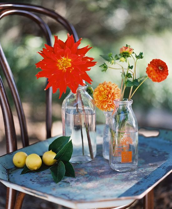Raise your glass and toast this simple flower arrangement via @Mary Snipes & Ink—perfect for a summer wedding