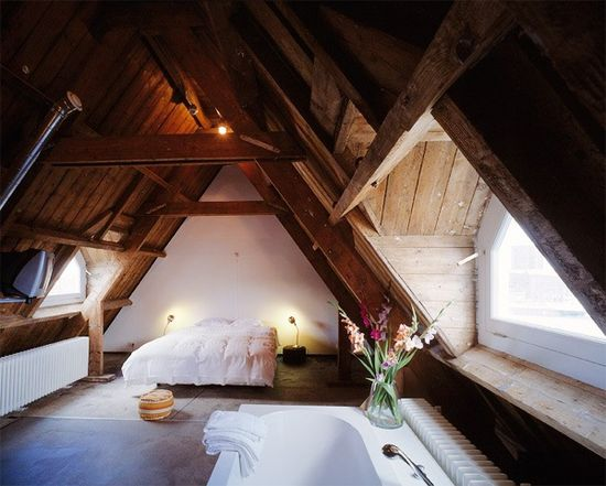 Simple attic bedroom with bath. Love the big window and exposed beams