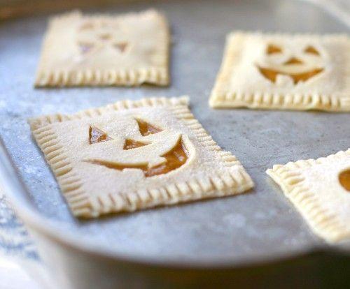 Adorable little Homemade Pumpkin Face Pop Tarts. #pop_tarts #tarts #pumpkin #pastry #cute #Halloween #food #baking #cooking #dessert #autumn #fall #breakfast