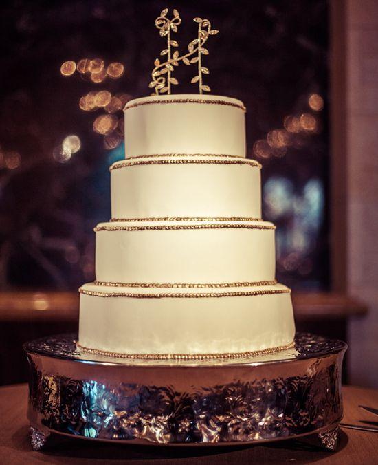 Circular White Wedding Cake // Photo: 2Me Studios // Event Design: YourBash! // blog.theknot.com/...