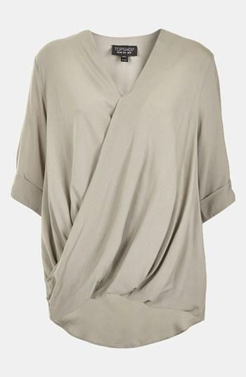 A draped top is always a great way to dress up a work look.