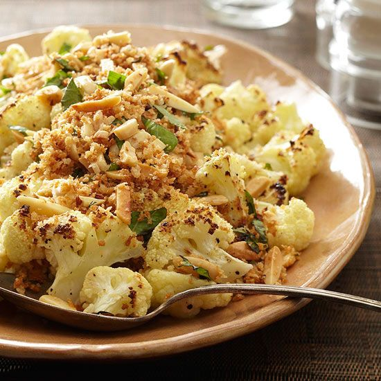 Our Parmesan-Roasted Cauliflower is made with garlic, Parmesan cheese, and panko crumbs. More delicious side dishes: www.bhg.com/...