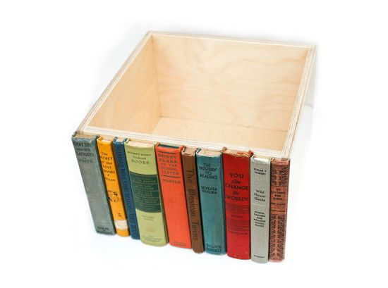 Old book spines glued to box, great way to store clutter on a shelf.