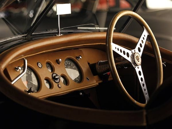 Style Redefined: The dashboard of the Jaguar XK120 Roadster 1950 vintage sport car.