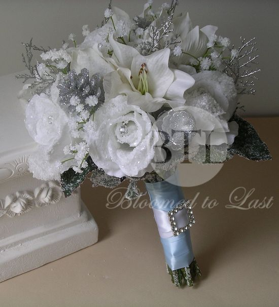 Winter Wedding BOUQET & BOUTONNIERE SET in White, Silver and Glacier Blue. Snow covered roses, silver Ice branches, pine cones and rhinestones. $225.00, via Etsy.