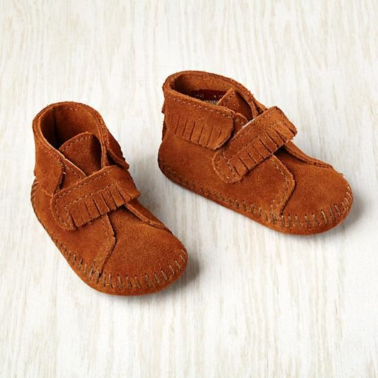 The same great look of Minnetonka's adult moccasin, shrunk down for your little one. Booties feature an adhesive front closure for easy wear. Made of 100% suede leather by Minnetonka.
