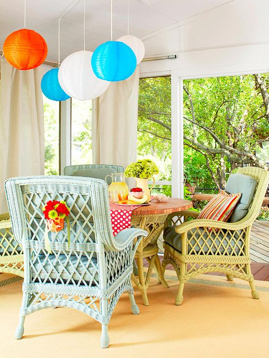 Paper lanterns add a whimsical touch to this colorful porch. More indoor porches: www.bhg.com/...