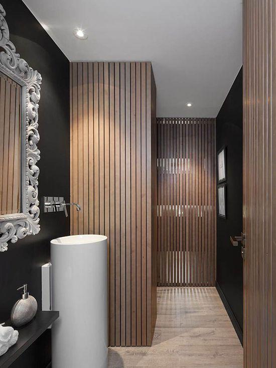 Vertical partition walls, pedestal sink, mirror