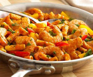 Heat oil in a large nonstick skillet over MEDIUM-HIGH heat. Add garlic and cook for 1 minute. Add shrimp and wine; cook until the wine evaporates.