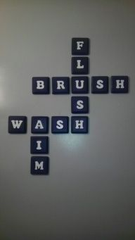 Bathroom decor idea - OK I need this FOR SURE!!! Especially the AIM with my 3 sons! LOVE IT