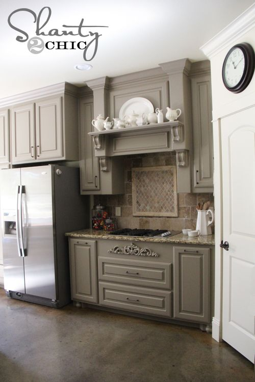 gray kitchen cabinets... Link and info to grey paint color! Love it