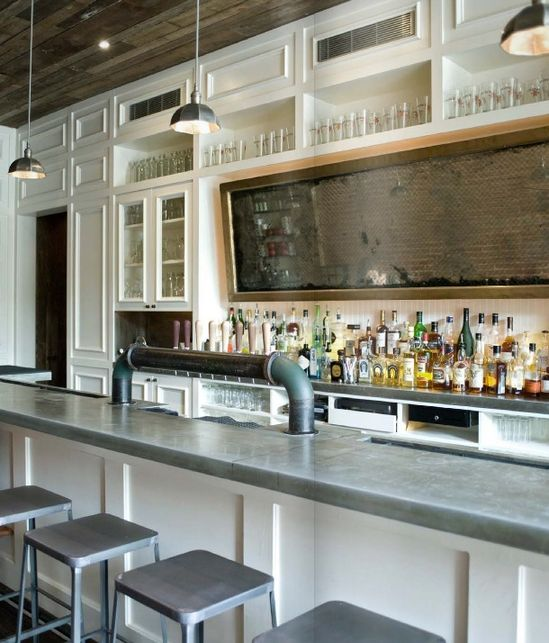 Steel industrial stools serve as counter seating