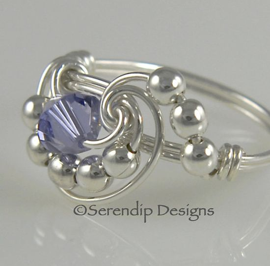 I love the technique of wire wrapping.  This is a very unique ring I'd like to learn to make.