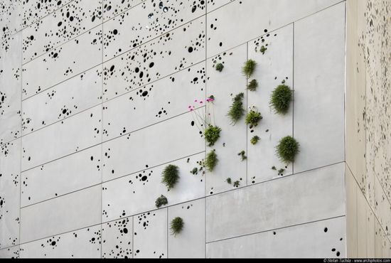 San Telmo Museum; a semi-plant wall covering the building with perforated steel sheets