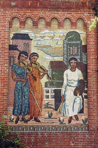 Pensive, unhappy UCBerkeley music and art mural, Berkeley, California, USA