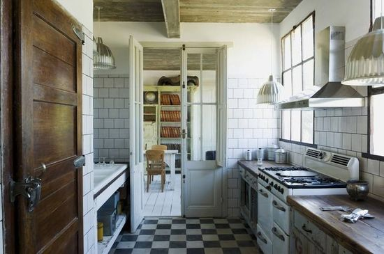 #black and #white #checkered #kitchen #floor #interior #design #photography from #http://www.remodelista.com/posts/hotels-and-lodging-casa-zinc
