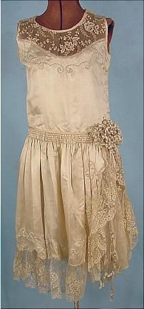 1920s Silk Wedding Dress with Lace and Pearl Detail and a Lily of the Valley Decoration at the Hip.