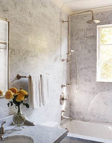 Michael Smith in House Beautiful. Utilitarian bathrooms were redone with brick-shaped Calacatta marble tiles and fixtures from Smith's Town collection for Kallista, which look as if they have been there forever.