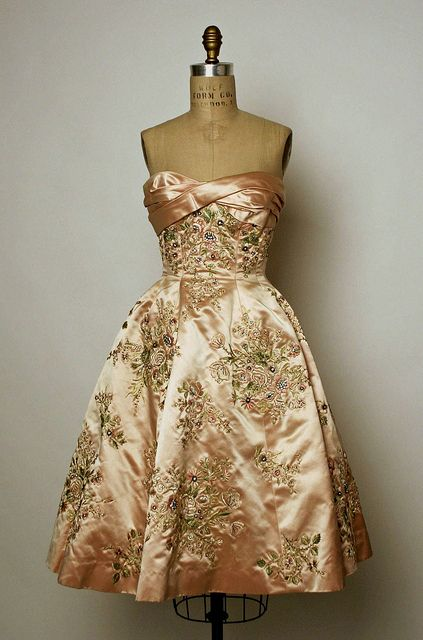A sublimely lovely silk peach, heavily beaded evening dress from 1956.
