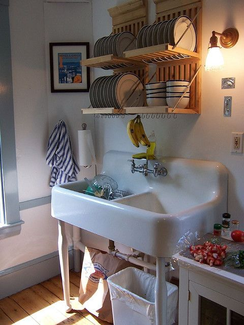 Love the drying rack over the sink.....and store the dishes there too!