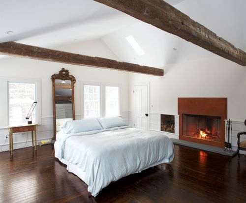 lovely white interior with dark wood floors, #interiors #interior design #bedroom #fireplace #attic