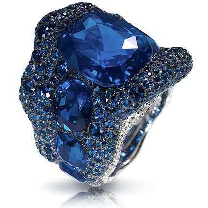 Vagabonde Bleue Ring - Les Fauves de Fabergé. This piece is set in 18 carat white gold and silver and features 618 white diamonds and sapphires totalling 18.79 carats. The centre stone is a cushion sapphire totalling 12.46 carats.