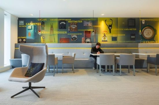 Gray on Gray seating, yellow stripe and buttons. also love the light fixture.