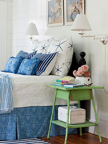 Blue and white bedding with a bright green bedside table