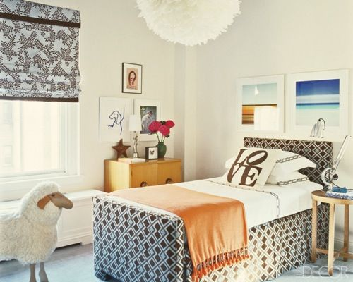 Love everything about this kids room; the sophisticated palette, the LOVE pillow, the preppy print, and the wooly life-size lamb. Designed by Phillip Gorrivan, Elle Decor.