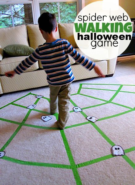 spider web walking. Use paint tape and mark off web. Place spiders on open parts of web and ghosts on the web. Object  is to pick up all the spiders but not step on the ghosts. Don't step off the web or you start over.
